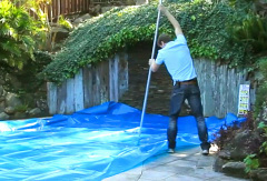 installing-pool-cover-broom