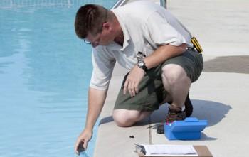 Man testing the pool water