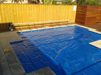 Swimming pool blanket covering pool