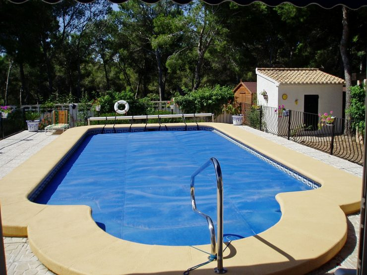 backyard pool with cover
