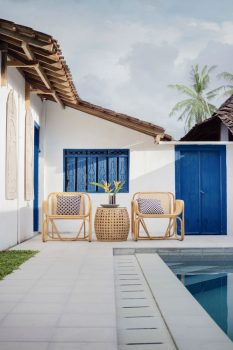 House with pool and chairs