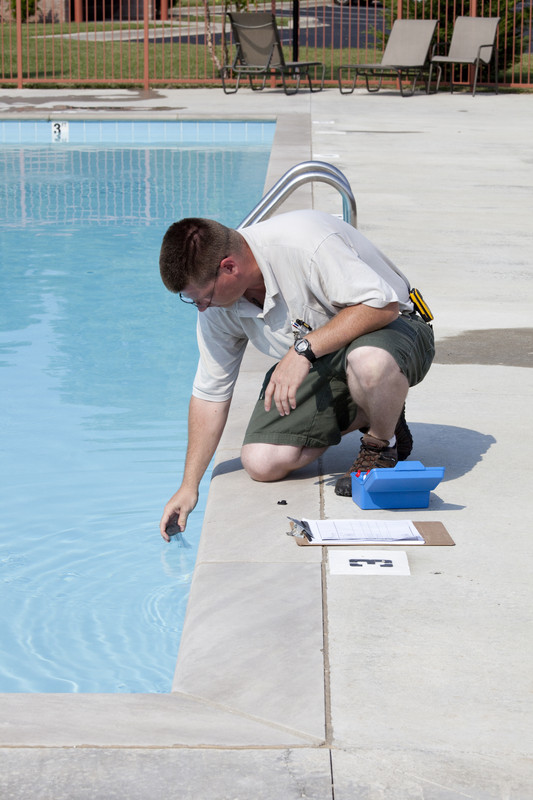 man testing for low alkalinity in swimming pool water